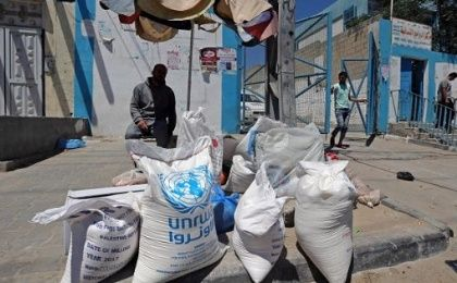 A Palestinian man sits outside the United Nations food distribution center in Khan Younis in the southern Gaza Strip.