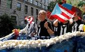 Oscar Lopez Rivera on gets a place of honor on first float in the New York Puerto Rican Day Parade.