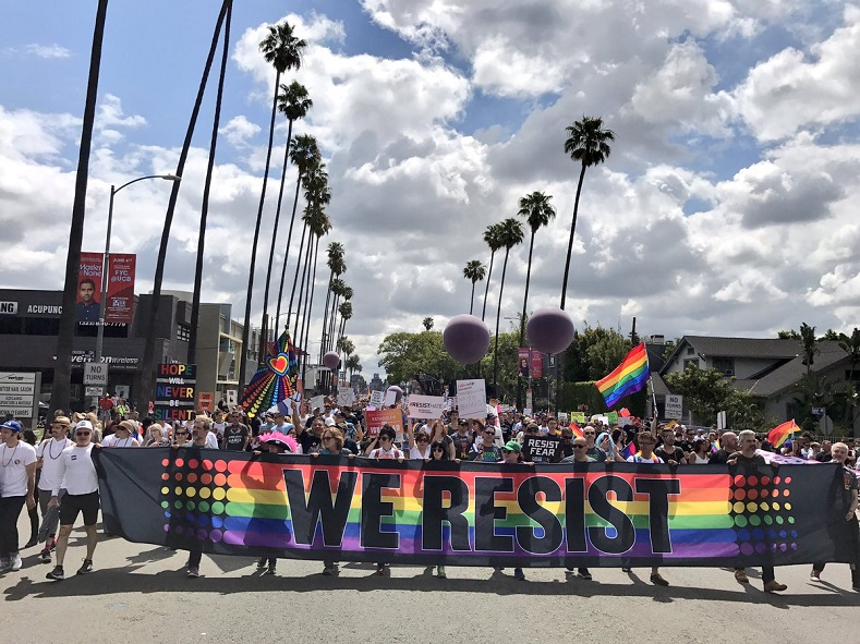 """We Resist"" banner as Los Angeles LGBTQ Pride parade attempts to be more militant and inclusive."