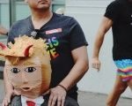 Miguel Luevano of Pasadena holds a Donald Trump piñata at the #ResistMarch during the annual LGBTQ Pride parade in Los Angeles, California, June 11, 2017.