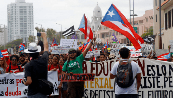 University students march against budget cuts in San Juan.