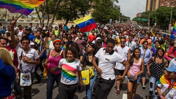 LGBTI community members and activists march in Caracas, June 29, 2014.