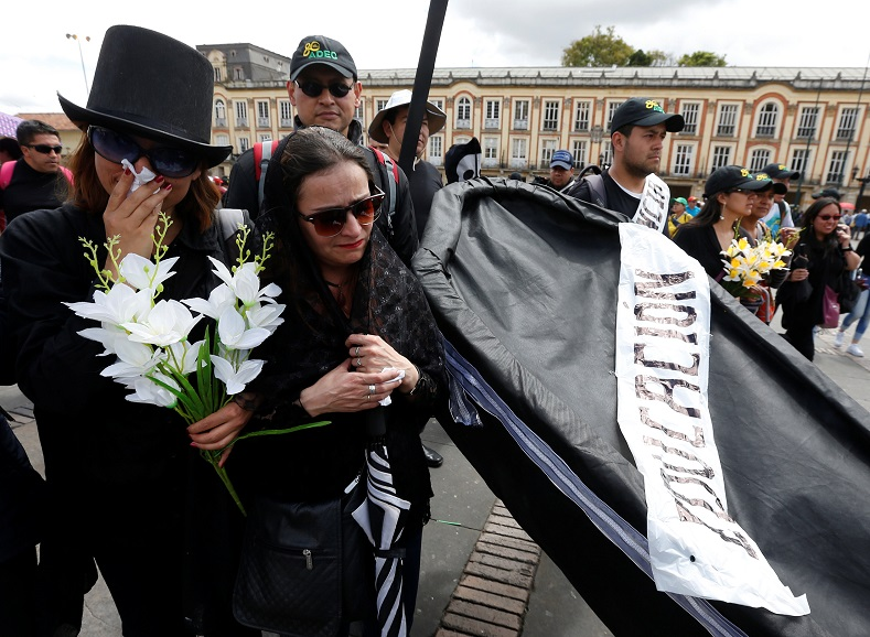 Teachers stage a mock funeral during their month-long protests for better wages and school facilities.