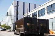 United Parcel Service vans parked outside the company's packing facility where a shooting incident took place