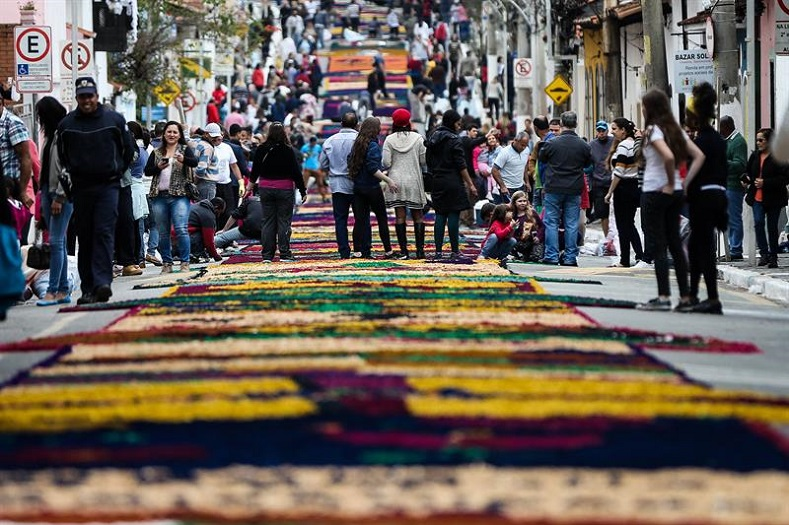 "A procession in the city of Santana de Parnaiba in Brazil. The streets are covered in ""rugs"" made from a combination of sawdust and flowers"