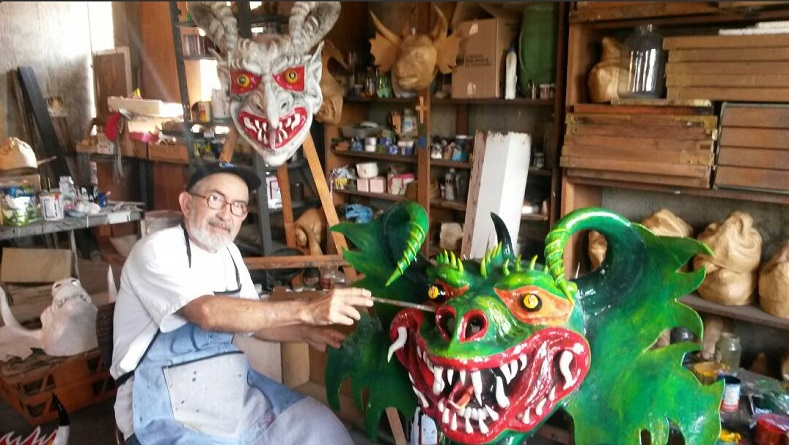 Juan Morgado has made Dancing Devil masks for over 40 years. One of the most respected craftsmen in Yare, Venezuela is seen here in his workshop