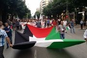 A large Palestinian flag leads the demonstration against the visit of Prime Minister Netanyahu in Thessaloniki.