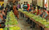 Nearly 800 migrant workers enjoy a grand traditional Kerala-style feast.