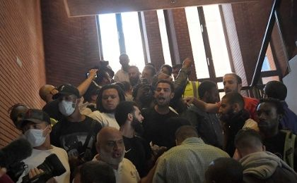 Demonstrators enter Kensington Town Hall, during a protest following the fire that destroyed The Grenfell Tower block, in West London, UK - June 16, 2017