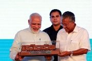 India's Prime Minister Narendra Modi (L) receives a model of Kochi Metro after he inaugurated the transport system in Kochi, India, June 17, 2017