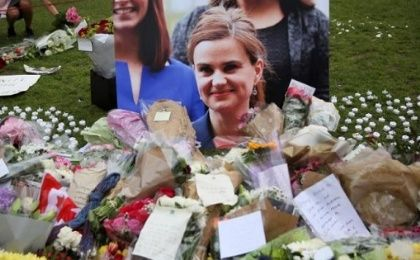 Tributes in memory of murdered Labour Party MP Jo Cox, who was shot dead in Birstall, are left at Parliament Square in London, Britain, on June 18, 2016.