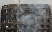 Smoke billows from a tower block severly damaged by a serious fire, in north Kensington, West London, Britain June 14, 2017.