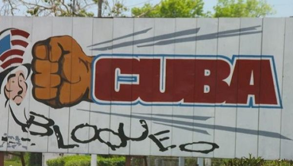Billboard against U.S. blockade of Cuba.