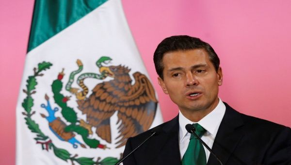 Pena Nieto signed the bill Thursday afternoon and sent it to the Supreme Court for review in a bid to ease the discontent among human rights organizations.