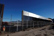 A worker stands next to a newly built section of the U.S.-Mexico border fence at Sunland Park, U.S. opposite the Mexican border city of Ciudad Juarez, Mexico.