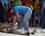 Officials cover the body of Honduran journalist Victor Funes after he was found shot dead in La Ceiba, June 15, 2017.
