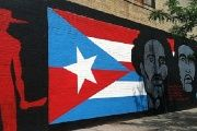 Che Guevara and Don Pedro Albizu Campos are shown along with the Cuban and Puerto Rican flags in this Spanish Harlem mural titled,
