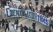 "Chilean students carry a banner that says ""Education Free for All."""