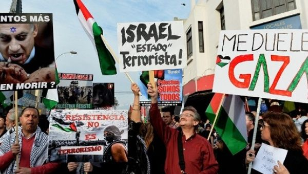 People rally in Santiago, Chile, on Aug. 2, 2014, to protest against Israel's military campaign in Gaza.