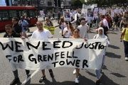 Demonstrators march during a protest about the Grenfell Tower fire, in London, Britain, on June 21, 2017.