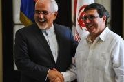 Iran's Foreign Minister Mohammad Javad Zarif (L) shakes hands with his Cuban counterpart Bruno Rodriguez in Havana, on Aug. 22, 2016.