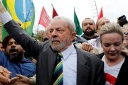 Former Brazilian President Lula de Silva surrounded by supporters as he testified in Curitibia last month.