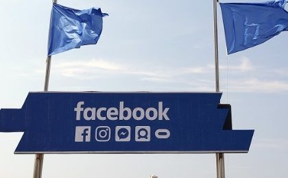 The logo of the social network Facebook is seen on a beach during the Cannes Lions Festival in Cannes.