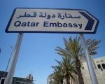 A sign indicating a route to Qatar embassy is seen in Manama, Bahrain.