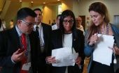 Venezuelan Foreign Minister Delcy Rodriguez (C) check some documents with the delegation after a meeting with foreign ministers ahead of the OAS 47th General Assembly in Cancun, Mexico, June 19, 2017.