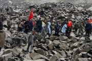 Rescuers search for survivors following a landslide in China that left 141 missing.