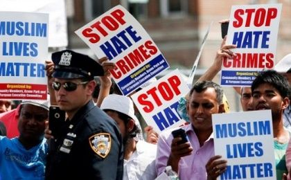 Community members take part in a protest to demand stop hate crime in Queens, New York.
