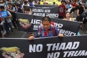 South Korean protestors march toward the US embassy during a rally against the deployment of the U.S. Terminal High Altitude Area Defense (THAAD) system in Seoul on June 24, 2017.