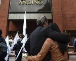 Relatives of the victims in a vigil outside the Andino mall in Bogota.