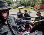 Members of the Philippine National Police Special Action Force ride on a truck in Iligan, as government forces continue their assault against insurgents from the Maute group, who have taken over large parts of Marawi City, Philippines.