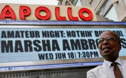 Historian Billy Mitchell poses outside the Apollo Theater in the Harlem section of New York City, June 11, 2014.