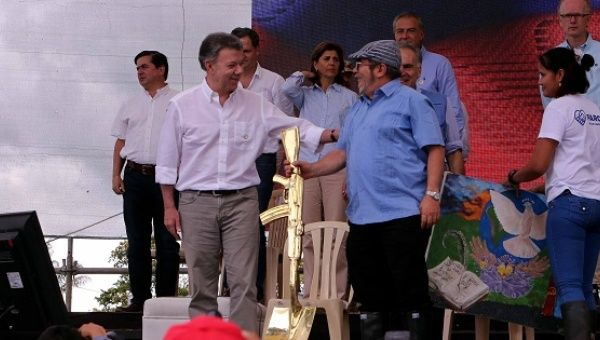 Timochenko and the Colombian President Juan Manuel Santos during the disarmament ceremony