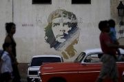 People walk past a painting of late revolutionary hero Ernesto ''Che'' Guevara in Havana, March 16, 2016