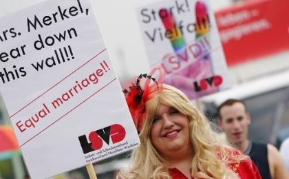 A reveller of the annual Christopher Street Day gay parade holds a placard in Cologne, western Germany, on July 5, 2015
