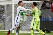Chile's Claudio Bravo (L) celebrates with Gary Medel after saving three penalty shots against Portugal during the FIFA Confederations Cup Russia 2017.