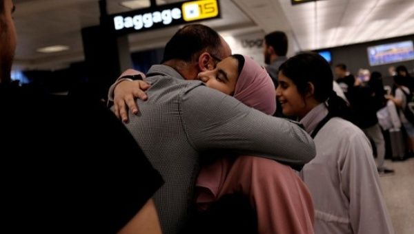 A Saudi family embrace as members arrive at Washington Dulles International Airport in Dulles, Virginia, U.S., on June 26, 2017.