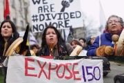 Indigenous protesters march toward Canada's parliament building in Ottawa, Jan. 11, 2013.