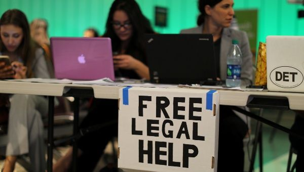 Volunteer lawyers set up a table to help arriving passengers at Los Angeles International Airport, California, U.S., June 29, 2017.