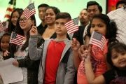 Children say the pledge of allegiance during a ceremony to present citizenship certificates in Los Angeles, California, U.S., on May 31, 2017.