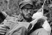 Cuban guerrilla leader Fidel Castro does some reading while at a rebel base in Cuba's Sierra Maestra mountains in 1957.