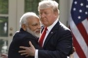 India's Prime Minister Narendra Modi hugs President Trump as they give joint statements in the Rose Garden of the White House.