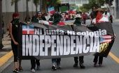 Puerto Ricans march in support of becoming an independent nation. The sign reads