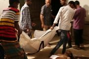 People line up the bodies of workers who died in a boiler blast at a garment factory in Gazipur, Bangladesh