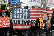 Demonstrators burn a mock U.S. flag during a rally opposing the U.S.-Philippines joint military exercises outside the U.S. embassy in Manila, Philippines.