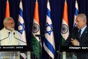 Indian Prime Minister Narendra Modi (L) stands next to his Israeli counterpart Benjamin Netanyahu as they deliver joint statements.