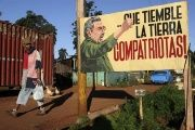 A man walks near a sign with an image of Cuban President Raul Castro in Havana December 19, 2014.